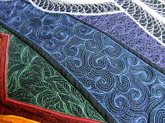 Coloured thread on black wholecloth by the amazing Leah Day