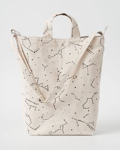 A perfect everyday tote in durable recycled cotton canvas duck. Two handles and 40 in. adjustable strap, to carry in hand or over shoulder. **** 16 in. H x 10 i