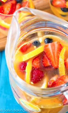 Sparkling Fruit Sangria filled with champagne, berries, oranges, and more. There's always a reason for celebrating with sangria! Champagne Sangria, Sparkling Sangria, White Wine Sangria, Moscato Sangria, Summer Drinks, Fun Drinks, Beverages, Fun Cocktails, Cocktail Drinks