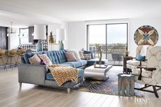This living room features a Jake Raf sectional by Century Furniture—covered in both Schumacher's Glimmer fabric in Peacock and Kirkby Design's Orion Velvet in Lagoon.