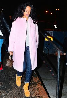 Rihanna looks casually cool in a pink coat and Timberland boots.