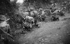 Troops of 6th Royal Scots Fusiliers, 15th (Scottish) Division, fire from their positions in a sunken lane during Operation 'Epsom', 26 June 1944. The soldier firing the Bren Gun is Charles Hanaway.