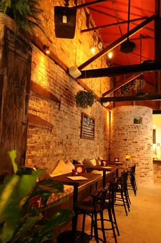 Bricks, exposed beams and concrete floor.