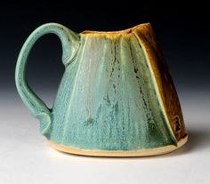 Altererd Turquoise Creamer by nick devries pottery. Nice handle and love the glaze