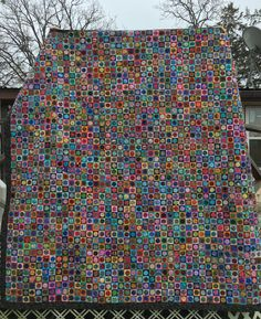 """""""Shenanigans"""", by Sara Brock, hand appliqued circles, machine pieced, started Feb. 2016, finished Feb. 2017.  Squares finished at 2"""", long arm quilted by Laura Coble.  Queen sized.  #18"""