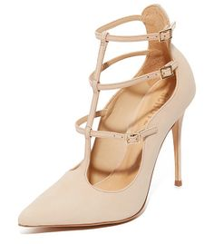 Welly strappy pumps by Schutz. Suede Schutz pumps styled with a scalloped top line and a pointed toe. Slim straps with buckle closures. Covered stil...