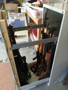 Beautiful Gun Cabinet Hidden Behind A Bookshelf..weu0027ve Been Wanting To Do This For A  Long Time! | Cool Stuff For The House | Pinterest | Guns, Storage And House