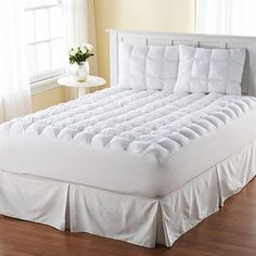 Magic Loft Mattress Topper.  This is THE BEST topper you will ever sleep on!!