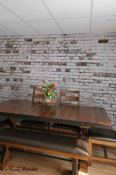Distressed Brick Wallpaper looks stunning in this dining room. The realistic design adds tons of texture to walls and it's even washable. The decaying white paint over red bricks creates an industrial, loft look. Brick wallpaper from About Murals is easy to hang, removable and eco-friendly. Brick Wallpaper Dining Room, Faux Brick Wallpaper, Old Brick Wall, White Brick Walls, Brick Texture, Old Bricks, Good Old, White Paints, Belle Photo