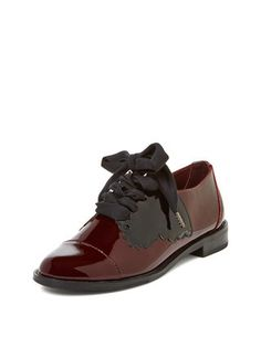 Based in London, F-Troupe honors its origins by weaving references to British history throughout its modern-vintage collection of women's shoes and boots. Here you'll find black Victorian-style button-down boots, stitched saddle shoes, bathing shoes, sailor brogues, hiking boots, and many other styles constructed from wool tweed, rubber, leather or sheepskin. Embellishments such as lace detailing, quilting, and knots add an extra touch of style to F-Troupe's mostly no- or low-heeled shoes…