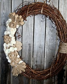 This large (24 inch in diameter) wreath is the Rustic Rancher Wreath series. This wreath is the perfect size for larger doors, above fireplaces,