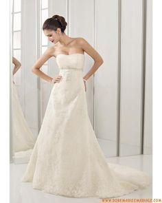 Belle robe de mariée bustier ivoire dos nu décorée de cristal organza