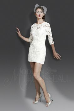 This vintage looking re-embroidered lace minidress with three quarter sleeves and bateau neckline is perfect for a rehearsal dinner, reception, or the big day.