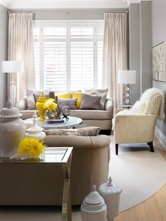 This lovely living room is decorated in soft neutral shades of gray and beige, with eclectic accent pieces and bright pops of sunny yellow. (via Jennifer Brouwer (Jennifer Brouwer Design))