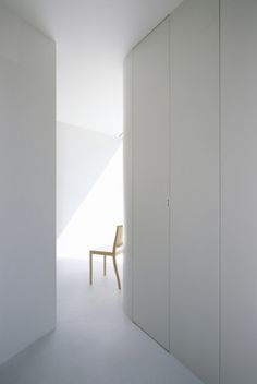 The House in Komae, Japan, designed by architect Makoto Yamaguchi, is mostly lit by natural light.