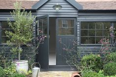 A unique summerhouse built for an urban garden with Farrow & Ball Off Black painted exterior cladding and a calming, restful interior in greys and whites. Painted Garden Sheds, Painted Shed, Farrow Ball, Exterior Paint, Exterior Colors, Garage Exterior, Exterior Cladding, Exterior Trim, Black Exterior