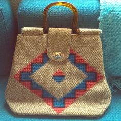 Vintage Aztec handbag/ purse This beautiful bag is in excellent condition for a vintage bag. No rips, tears, or stains. Amber colored lucite handles, and gold buttons on bottom. A one of a kind bag! Bags Totes