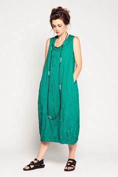 "Verbena Dress in Emerald Carnaby Bubble shaped dress with stand-up geisha collar, side pockets, and elasticized hem. Wear over a long skirt or on its own! Length approx. 48"" from shoulder to hem.  EMDD001 Fabric: Carnaby (Light Cotton) Colour: Emerald Style: Dress - Sleeveless Designer: Kaliyana"