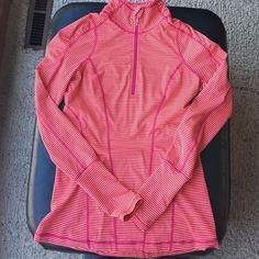 Zella quarter zip pullover Beautiful Zella quarter zip pull over in hot pink and orange stripe! Thumb holes on the sleeve! Great buy! In perfect condition! Zella Tops Sweatshirts & Hoodies