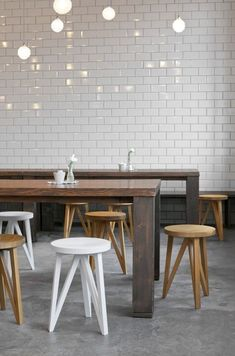 /Subway tiles, stools, wood tables.