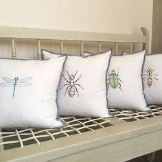 Contemporary embroidered cushions made using the Anatomical Insects hand embroidery pattern by Kelly Fletcher at https://www.etsy.com/shop/KFNeedleworkDesign. #embroidery #handembroidery #insects #pdfpattern
