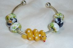 Year of the Snake Lucky Pandora Style European Bangle with Glass Lampwork Snake. $20.00, via Etsy.