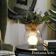 FontanaArte Giova Table Lamp has a middle globe in transparent blown glas and inner globe in polished white opaline glass. #FontanaArte #tablelamp #flowerpot #GaeAulenti Available at allmodernoutlet.com  http://www.allmodernoutlet.com/fontanaarte-giova-table-lamp/