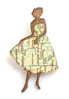 Chic Silhouette Map Pin by Yes & Yes Designs: Oakland-California-based designer Laura Bruland creates her handcrafted, laser-cut pieces from recycled books,