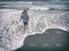 Boy playing in the surf