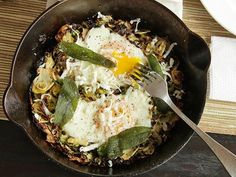 http://www.seriouseats.com/recipes/2012/11/brussels-sprouts-hash-fried-sage-soft-cooked-egg-recipe.html?ref=thumb  Make brunch in 10 minutes or less with this easy hash of brussels sprouts and shallots flavored with fried sage and cheese, topped with a runny egg.