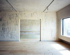 Another view of the 'unfiinished' wall inside Setagaya flat renovation by Naruse Inokuma Architects.