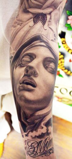 Realism Religious Tattoo by Eric Marcinizyn | Tattoo No. 8619