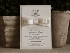 Elegant and Classic wedding invitation with beautiful satin loops from www.stephita.com