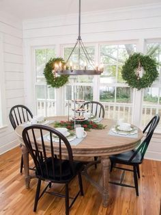 The dining table and chandelier in the kitchen of the newly renovated Magnolia House bed and breakfast, as seen on Fixer Upper. (after)