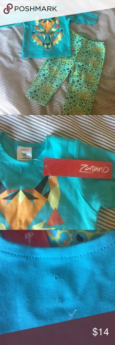 Zutano Knit Wolf Outfit NWT but there are 2 small holes where the price tag was mistakenly shot through the size tag AND the back of the shirt! I didn't notice when I purchased or I would've returned it. Still, a great, stylish little outfit if you live with the little holes! Priced accordingly. Zutano Matching Sets
