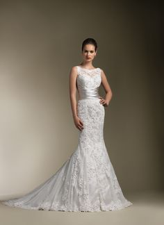 Justin Alexander wedding dresses style 8596 Sheer venice lace sabrina neckline accents this sweetheart neckline with pleated regal satin cummerbund at waist, textured lace trumpet skirt and chapel length train. Buttons over back zipper.
