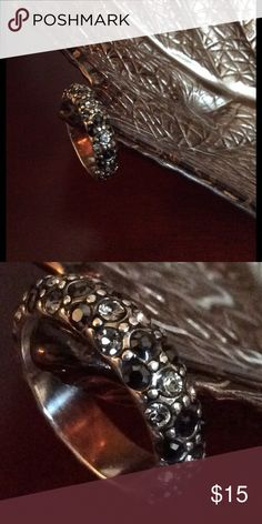 Brighton's Stackable Ring Brighton's Stackable Ring collection, silver band with lots of white and black Swarovski crystals all around band. Size 7. EUC Brighton Jewelry Rings