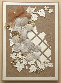 Created using Creative Expressions dies by sue wilson , Greek Island Back ground and finishing touches Ivy, Berry sprig and Chloe stamped flowers.