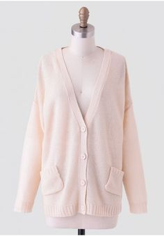 Effortlessly lightweight and relaxed, this cream-colored cardigan is designed with two front pockets and button closures at the front. Accented with open-knit detailing at the back, this cozy sweater is a layering essential that adds a hint of texture to any ensemble.