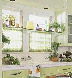 glass shelf over windows, for plants. sheer curtains match lower cabinets