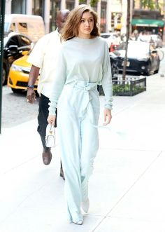Gigi Hadid aced monochromatic dressing in a pale blue Sally LaPointe ensemble.