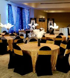 1920's Gatsby themed wedding decorations in black and gold with geometric art deco sequin tablecloths and spandex chair covers, ostrich feathers, from CV Linens. High quality wedding linens at an affordable price to make wedding planning easy and stress free. Geometric wedding theme and tablecloths for weddings and Gatsby themed parties! #gatsbyparty #gatsbywedding #gatsbythemedparty Gatsby Themed Party, Themed Parties, Gold Wedding Theme, Gatsby Wedding, Geometric Wedding, Geometric Art, 90 Round Tablecloths, Spandex Chair Covers, Sequin Tablecloth