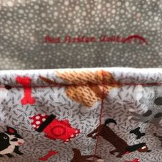 You're sure to find your favourite pooch amongst the whimsical dog mix of this tote bag.  The fabric on the top half of the bag is a colourful mix of dogs, bones and fire hydrants on an unobtrusive patterned grey background.  This is paired with a red brush-stroke patterned red fabric for the lower half and the handles.  The lining fabric has small tonal dots on grey.  –made with 100% quilting cotton on the outside and for the lining  –polyester batting/wadding  –interior pocket Red Fabric, Lining Fabric, Fire Hydrants, Dog Mixes, Gray Background, Your Favorite, Bones, Whimsical, Finding Yourself
