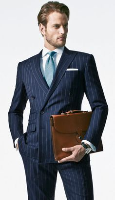 RL, Purple Label suit. Brioni tie. Montblanc watch. RL briefcase. Perfect double-breasted.