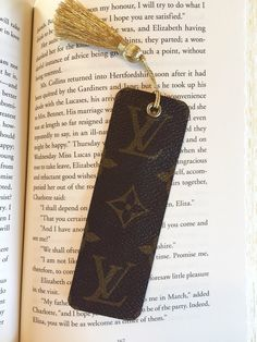 This bookmark is made from upcycled authentic Louis Vuitton canvas. It has a beautiful gold metallic tassel. Gold compliments Louis Vuitton