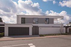 Die Bewohner dieses Einfamilienhauses wünschten sich ein modernes, stylishes und puristisches Zuhause - und bekamen ihr absolutes Traumhaus.