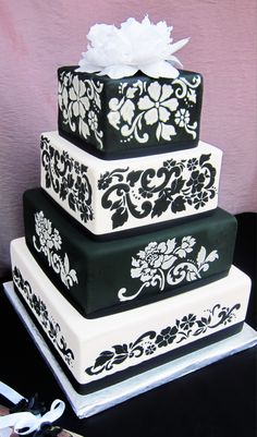 "Black and white stenciled cake - Black and white fondant covered cake with floral stencils. 12"" 10"" 8"" 6"" square"