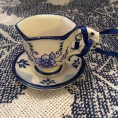 I love this pretty blue and white tea cup and saucer.