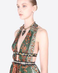 Logo<br>Plain weave<br>Unlined<br>Sleeveless<br>Contrasting applications<br>V-neckline<br> Women 34586056SP