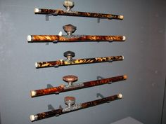A museum display of opium pipes adorned with tortoise shell. From a special exhibition at Holland's Kunsthal Rotterdam that was on display in 2007.